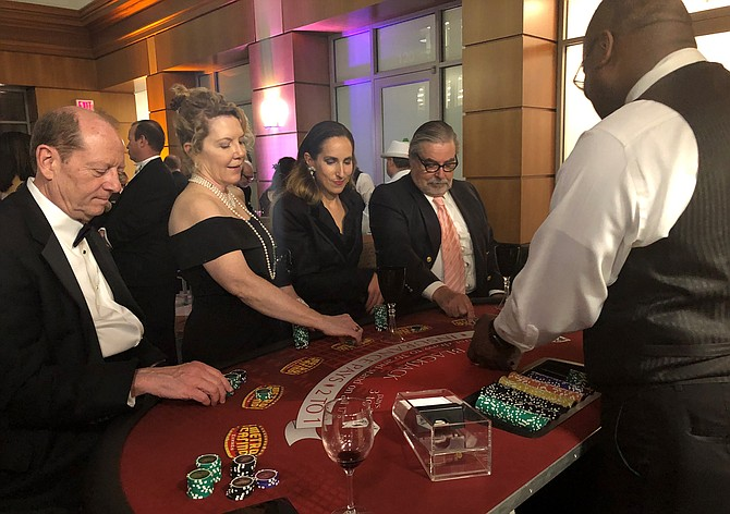 Steve Reed, Joan Renner, India Mertins and Richard Moorhouse enjoy a friendly game of poker at the Symphony Orchestra League of Alexandria's Gatsby's Speakeasy II gala April 13 at The Atrium. Now in its 32nd year, the annual SOLA gala raised funds for the Alexandria Symphony Orchestra.