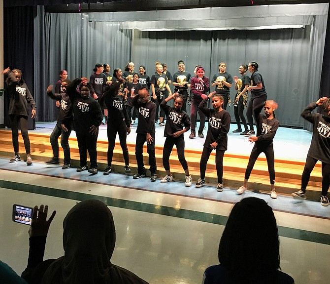 A drum line performance by students during the Black History performance held at Bells Mill Elementary School Friday.