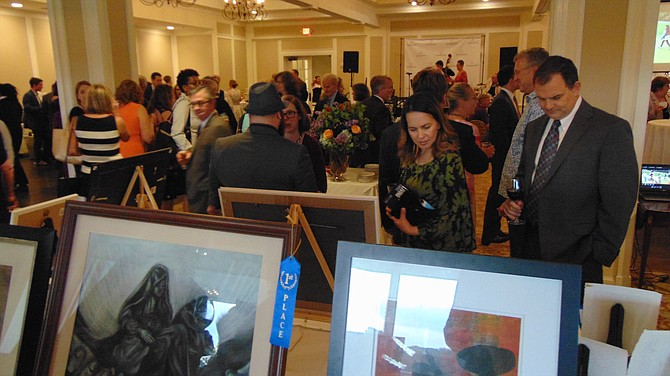 Guests peruse the silent auction items at the Britepaths Gala.