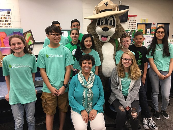 Lanier's Eco Team members and sponsor Faiza Alam (center, front) pose before the Green Flag ceremony.
