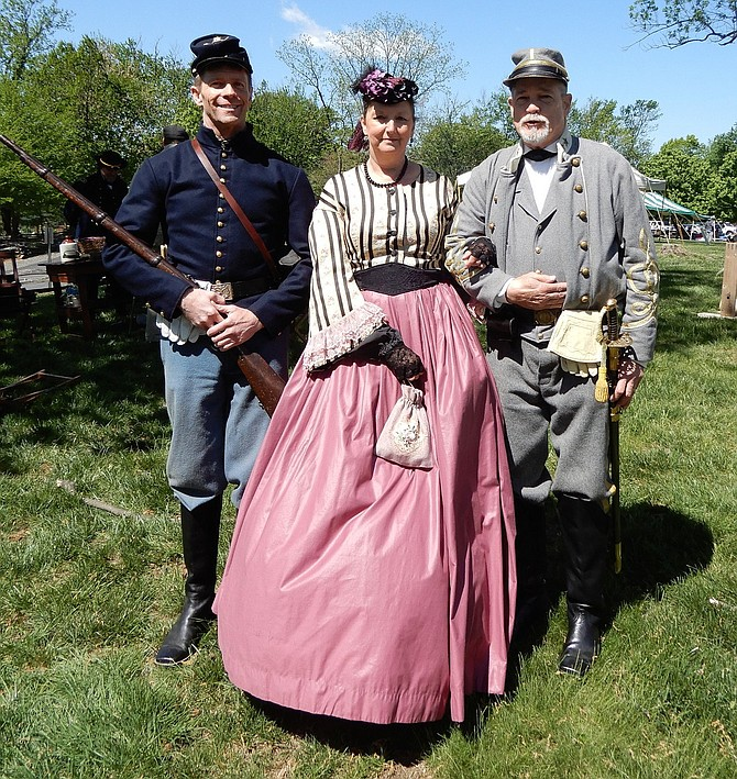 From left, Civil War reenactors, Scott Diezman with Wilder's Lightning Brigade; and Debbie and Mark Whitenton, both of the Fairfax Rifles.