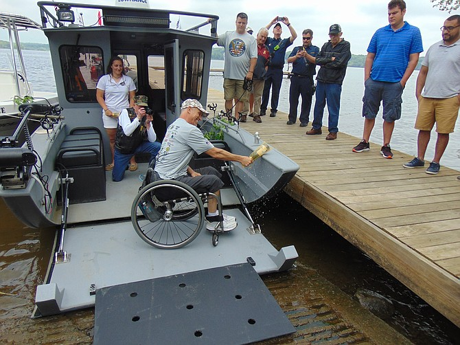 Mike Healy, Marine Corps veteran, christening the boat.