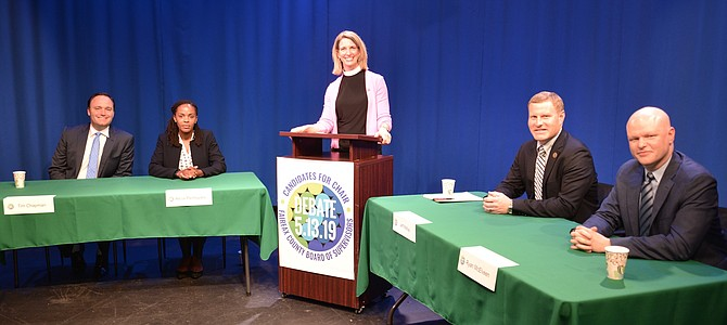 The Democratic candidates for the Chair of the Fairfax County Board of Supervisors, heading for the June 11 Primary election, debate at a live televised event, hosted by the Fairfax Healthy Communities Coalition. Coalition member and event moderator Pastor Sarah Scherschligt is flanked by candidates Tim Chapman and Alicia Plerhoples on the left, and Jeff McKay, Lee District Supervisor, and Ryan McElveen, At-Large member of the FC Public Schools Board on the right.