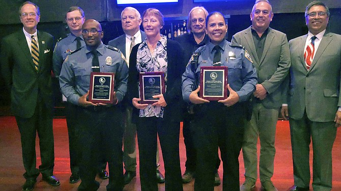 At the Arlington County Crime Solvers 2019 law enforcement awards luncheon: Back row from left, Dr. Patrick K. Murphy, superintendent of ACPS; ACPD Police Chief Jay Farr; Andres Tobar, Charles Meng, John Murphy, and Michael Garcia, ACCS board members. Front row from left: ACCS award recipients School Resource Officer (SRO) Detective Kevin Treakle, former SRO Supervisor Lieutenant Susan Noack, and SRO Detective Jackie Pagan.