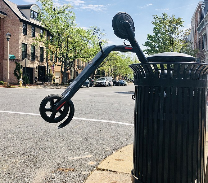 People unhappy with scooters have been vandalizing them in recent weeks. One was shoved into this trashcan at Queen and Fairfax.