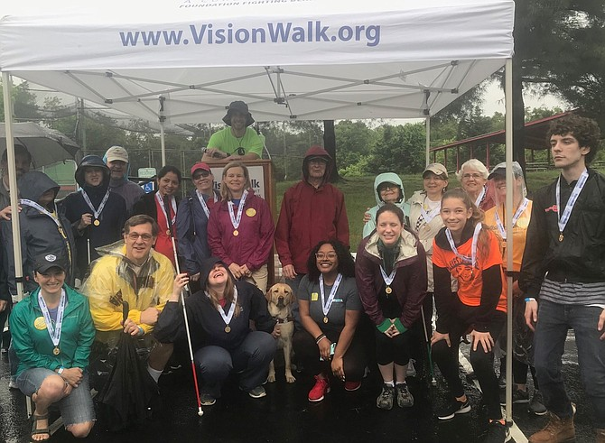 Walkers display their ribbons as the top fundraisers in the May 5 VisionWalk at Cameron Run Park.
