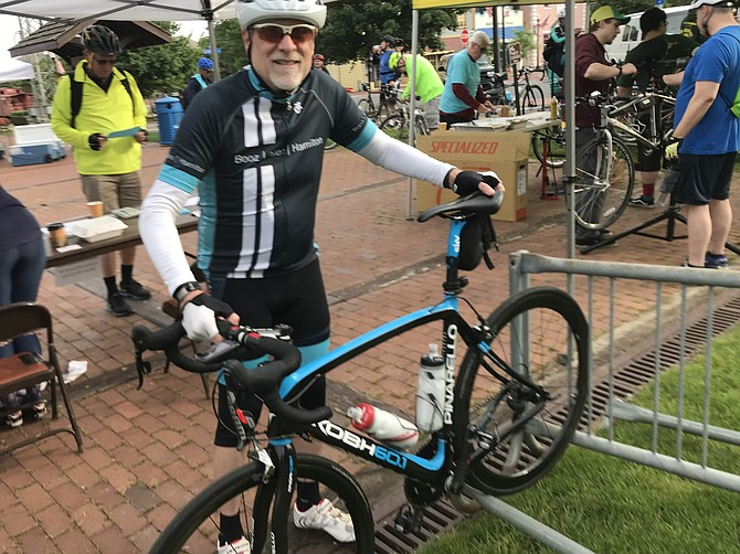 Tim Taylor of Chantilly stops at the Herndon Pit Stop to get a free t-shirt on Bike to Work Day 2019.