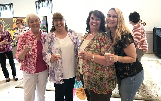 From left, Cheryl Engley – 40 years of service, Ann Chladon – 10 years of service, Joyce Burd – 20 years of service and Nora Saint Arnold – 10 years of service, celebrate and toast their long-standing teaching commitment at St. Timothy's Preschool in Herndon.