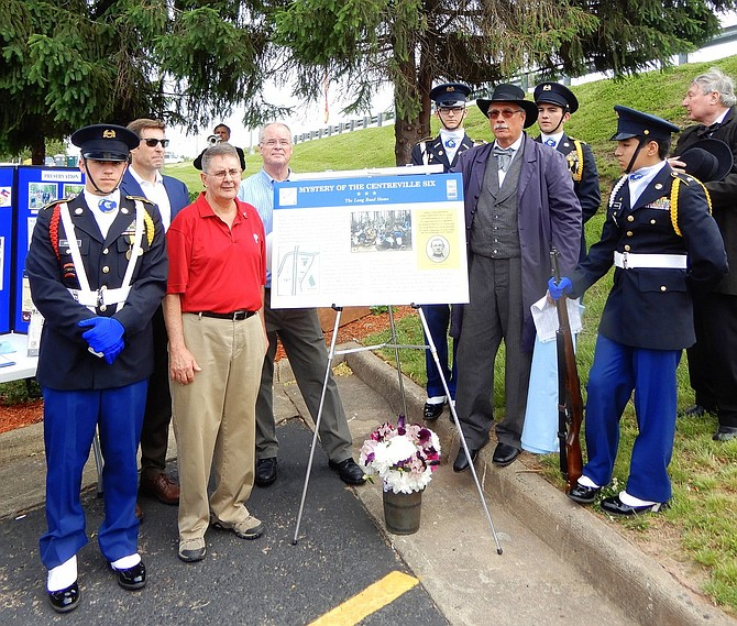 Unveiling of a historical marker honoring the Civil War soldiers found in Centreville. Former Sully District Supervisor Michael Frey is in red shirt; James Lewis is standing to the right of the marker.
