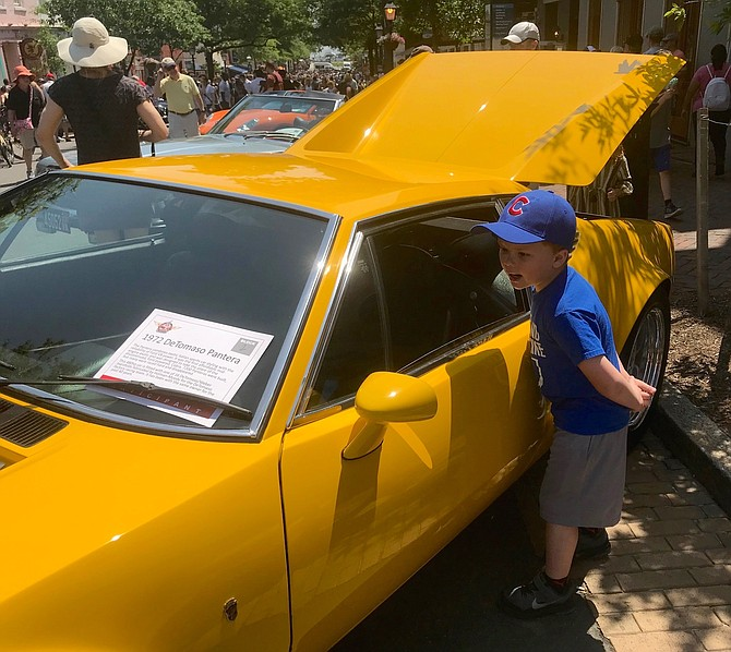 Jackson Cook of Petersburg, W. Va., checks out the inside of a 1972 De Tomasa Pantera at the Old Town Festival of Speed and Style May 19 on King Street.