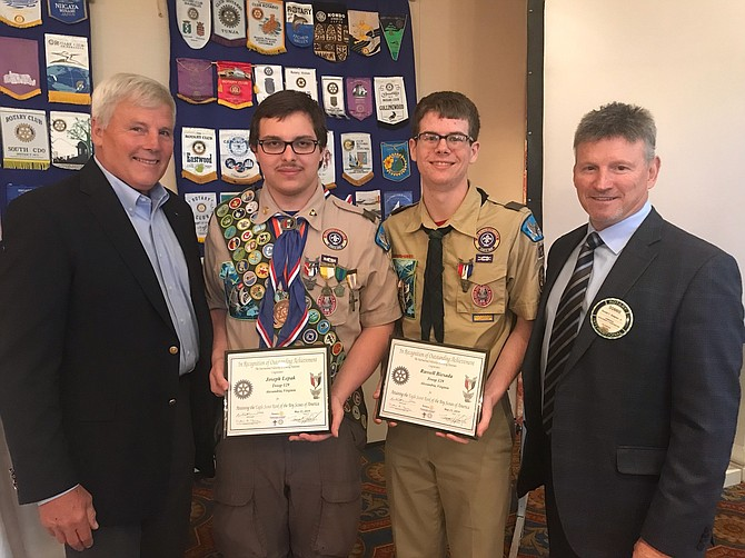 Eagle Scouts Russell Biesada and Joseph Lepak of Alexandria Troop 129 pose with Rear Admiral Stephen Oswald (ret) and Don Simpson Jr. at the 21st annual Rotary Scout Luncheon May 21 at Belle Haven Country Club. Biesada and Lepak were presented with Eagle Scout Scholarships on behalf of the Rotary organization.