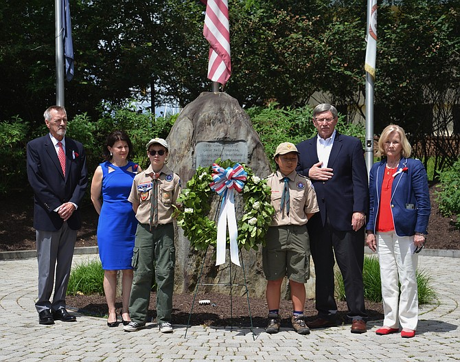 Elected officials participated in the remembrance ceremony as well. From far right, Great Falls Freedom Memorial president Andy Wilson is joined by, from left, State Sen. Barbara Favola (D-31), Dranesville Supervisor John Foust, and Del. Kathleen Murphy (D-34) to stand with Scouts Tommy Maxon and Melinda Hauda for the Laying of the Wreath at the Memorial.