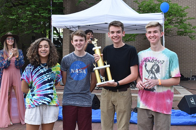 The slacker rock quartet from Reston, Fourth Electric, won the talent competition at Reston Live, a festival presented by the CORE Foundation.  Band members Kacey Banga, Charlie Moore, Elijah Bishop and Edwin Schoenborn display their winning trophy.