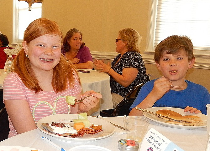 Siblings Sadie and Travis Jacobs enjoy last year's pancake breakfast.