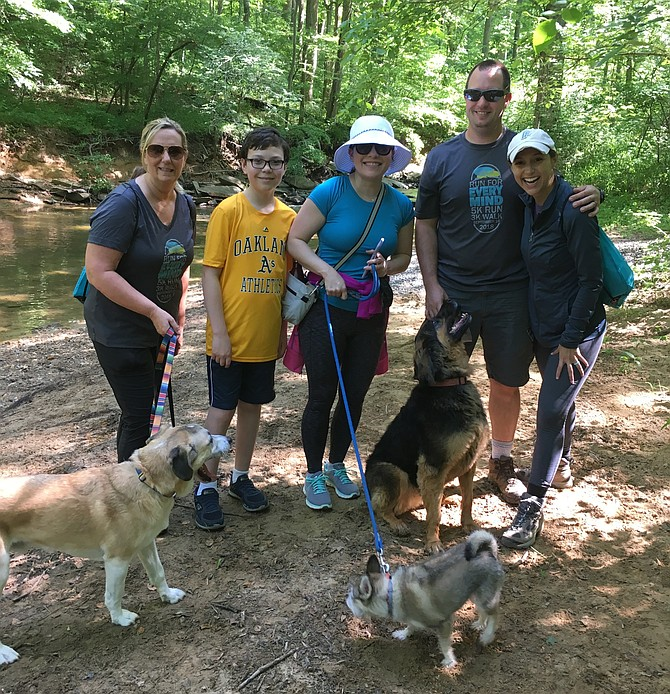 Lauren Strawbridge, right, is joined by her husband, Matt, and EveryMind staff at Cabin John Regional Park Sunday. From left are Ann Mazur, CEO; Gavin Roz, Emily Rosado, board member; Matt and Lauren Strawbridge.