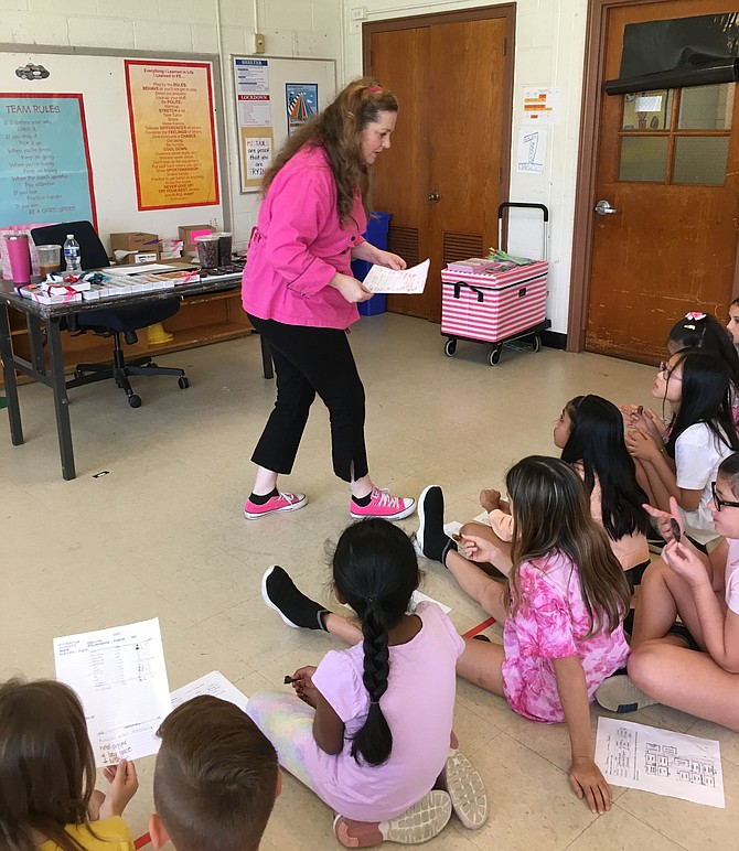Chocolatier Sarah Dwyer discusses the business of making chocolates with Potomac Elementary School students at Career Day Thursday.