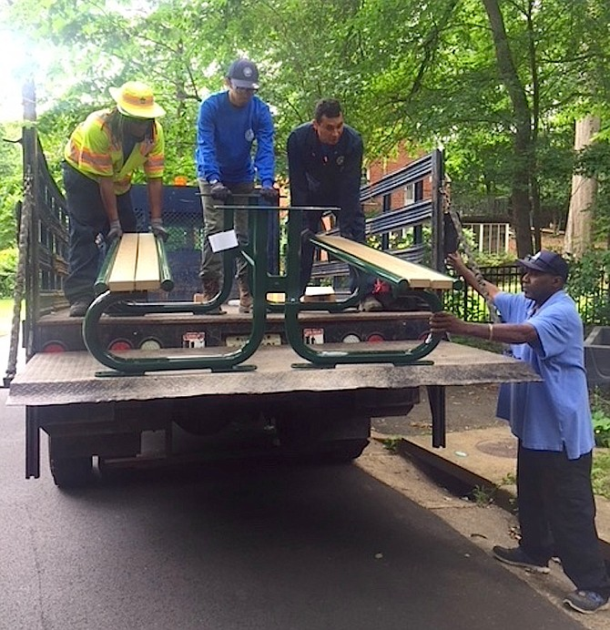 Recreation and Parks workers unload a new picnic table at Monticello Park.