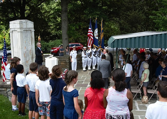 Attendees recite the Pledge of Allegiance to open the Memorial Day ceremony May 27 at Alexandria National Cemetery.
