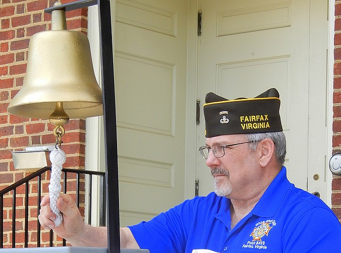 VFW Post 8469 Vice Commander Mac McCarl rings the bell after each name is read.