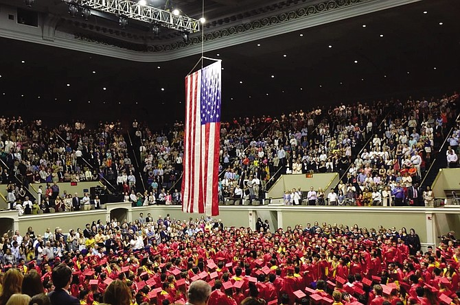 McLean High School Class of 2019 graduates rise for the Star Spangled Banner, performed by the McLean Madrigals and the McLean Band.