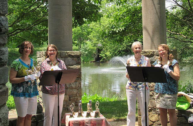Fannie Mae Ponds & Gardens. The Grace Notes Hand Bell Quartet — Linda Brese, Fairfax; Ingrid Bowers, Reston; Marilyn Schroeder, Fairfax; and Lisa Lane, Great Falls; perform in the stone gazebo overlooking one of the two ponds frequented with Great Blue Heron.