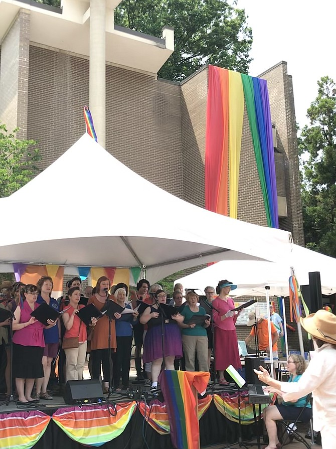 The choir for sponsoring churches of Reston Pride, conducted by Mary Lou Prince, Music Director Unitarian Universalist Church in Reston, performs a choral selection during Reston Pride 2019.