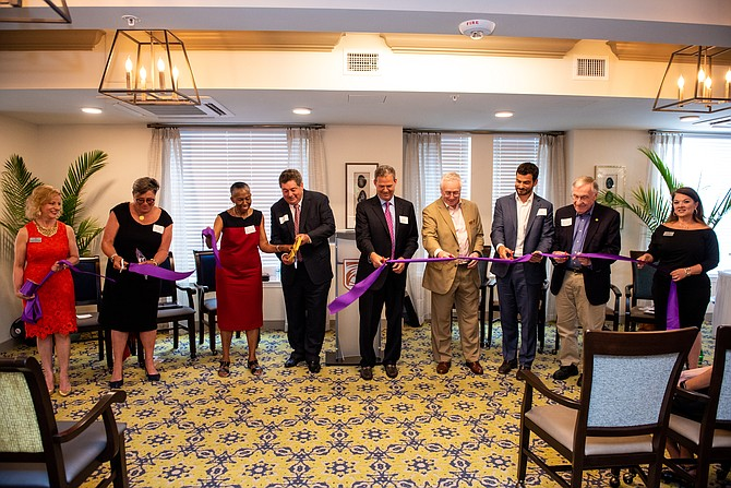 Annamarie Mariani-Huehn, Executive Operations Officer Hunters Woods at Trails Edge; Maggie Parker, Greater Reston Chamber of Commerce; Supervisor Catherine M. Hudgins (D-Hunter Mill); David Ross, Partner & President Atlantic Realty; Adam Shulman, Partner & Executive Vice President, Atlantic Realty; Rick Irwin, CEO & Co-founder, IntegraCare; Tony Crooks, Director at AEW Capital Management; Del. Kenneth Plum (D-36); and Cissy Nickel, Executive Director of Independent Living Operations at Hunters Woods at Trails Edge; all take part in the Ribbon Cutting officially opening the retirement living facility.