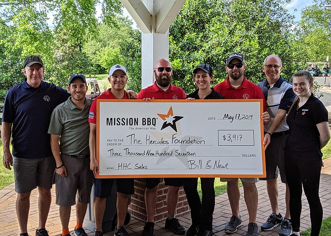 Pictured is the check presentation from one of the sponsors, Mission BBQ of Chantilly, to the Hercules Foundation. From left, Fran Lindenbaum, Hercules Foundation and Ryan's father; Jon Gridgemen, Mission BBQ general manager; Brian Beruete and Alex Fetterman, Hercules Foundation; Liz McGuirk, Mission BBQ ambassador; Andrew Donahoe, Hercules Foundation; Steve Bernbaum, Mission BBQ operations director; and a Mission BBQ employee.