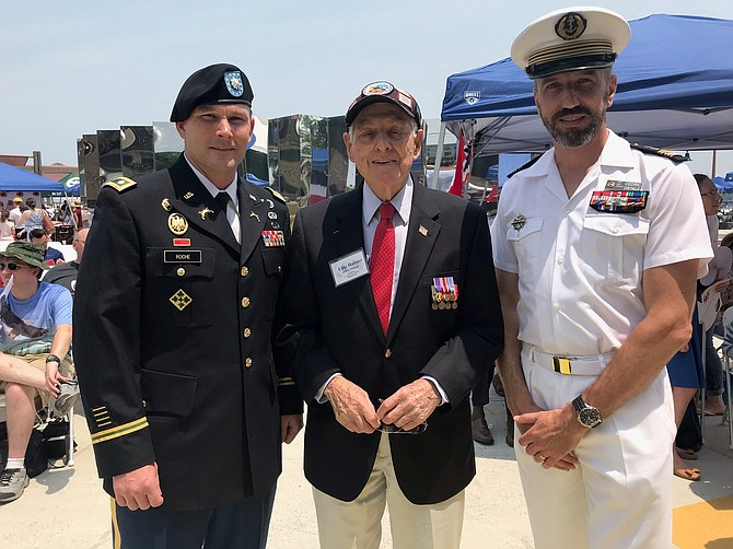WWII and D-Day survivor Lincoln Harner, center, of the US Army 987th Field Artillery Battalion (Gold Beach), with LTC John Roche, Commander Headquarters and Headquarters Battalion 29th Infantry Division, and Cedric Chetall, Capt. NW France, at the 75th D-Day Commemoration Ceremony June 1 at Waterfront Park.