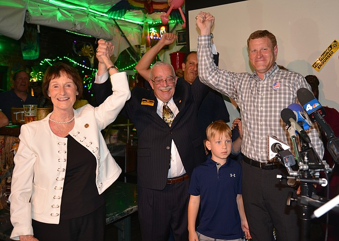 Celebrating the victory, from left: Fairfax County Board of Supervisors Chair Sharon Bulova, U.S. Rep. Gerry Connolly (D-11) and Lee District Supervisor Jeff McKay. Connolly was chairman before he was elected to Congress.
