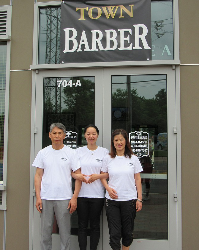 Town Barber is a locally owned family business; (from left) Luis Lim, daughter Joyce, wife Sun and a son stationed overseas at Osan Air Base, United States Air Force.