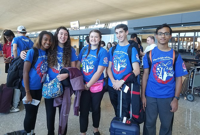 The first group of Herndon High School band members from the Pride of Herndon Marching Band, led by Director of Bands Kathleen Jacoby, prepares to depart Dulles International Airport shortly after noon on Tuesday, June 4, destination Normandy, France and the 75th Anniversary of D-Day.