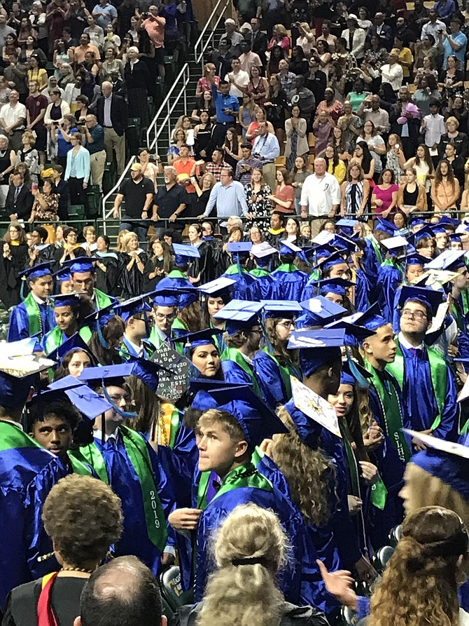 South Lakes High School Class of 2019 looks toward the stadium seating for their loved ones at George Mason University EagleBank Arena during their Commencement Ceremony held June 5.