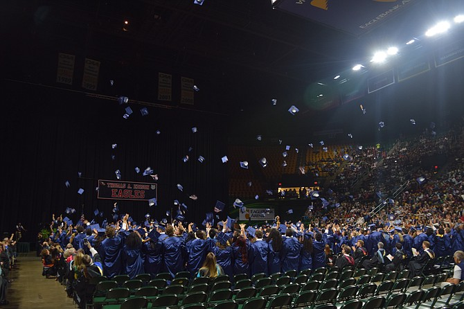 After they all walked across the stage, Edison graduates throw their caps in the air as they cheered and were officially declared graduates.