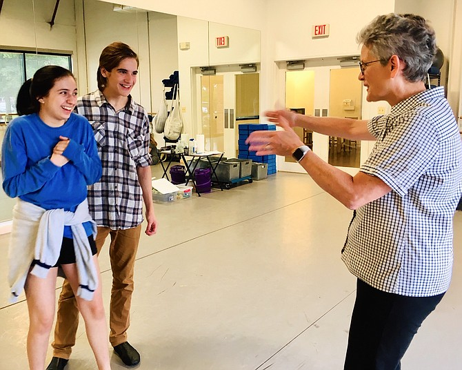 "Annie Farias (as Katherina) and Lewis Bliss (as Petruchio) rehearse a scene from ""The Taming of the Shrew"" with director, Barbara Schwartz."