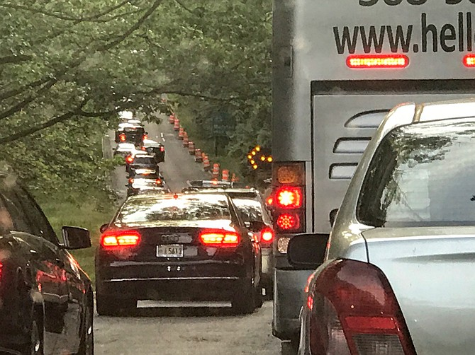 Traffic backs up on the George Washington Parkway northbound to merge around a sinkhole on May 21. When the NPS initially stabilized the sinkhole in mid-May, it was 10 feet deep, 30 feet long and 20 feet wide. Construction will continue through most of the summer.