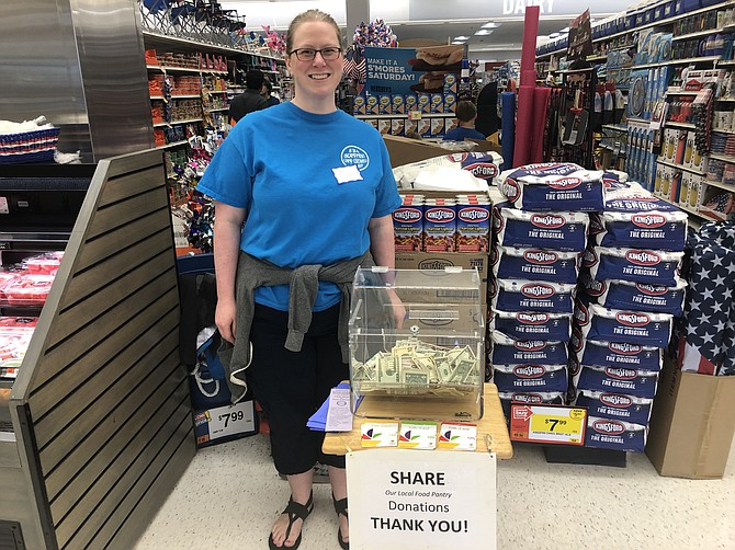 Jennifer Ruscio stood near the checkout aisles inside the grocery store to collect cash and gift card donations from shoppers.