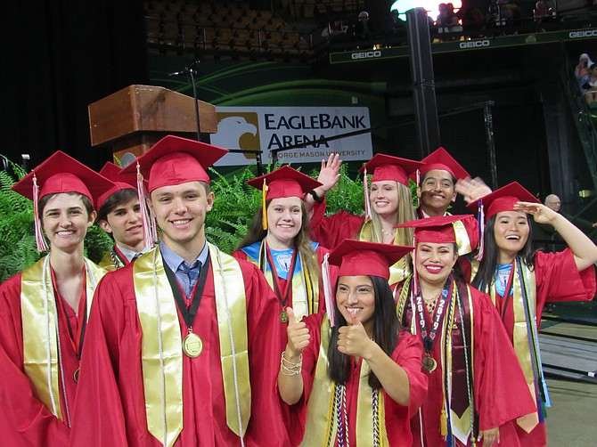 The Herndon High School Senior Class Council, Cristian Lainez, Sari Levine, Angelina Margraf, Joseph Parodi, Kelsey Rogers, Sebastien Roy (not pictured), Alison Stern, Amberly Silva-Arriaga, Ellie Wichman and Michelle Tran pose one last time before the start of the Class of 2019 Commencement.