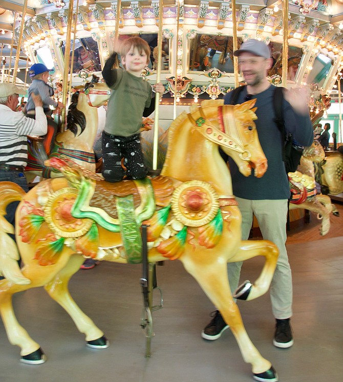 Christian and James Lowe on Carousel Day at Glen Echo. Ride it in May and June because in 2019, the carousel will be closed for construction from July through September. It will reopen in Spring 2020.