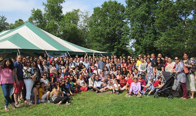 A small segment of the more than four hundred community members who attended the 2019 Model Nepal Society Potluck Picnic gather outside the canopy to record the moment.