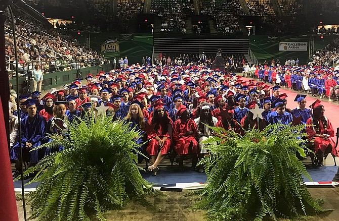 Members of the T.C. Williams High School class of 2019 await the start of graduation ceremonies June 15 at Eagle Bank Arena.