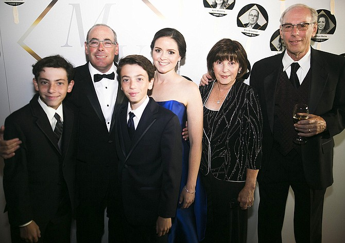 From left, are Ethan, Eric and Alex Grossman; Eric's girlfriend, Desiree Termine; his mother, Myrna Hyman and her husband, Paul Hyman.