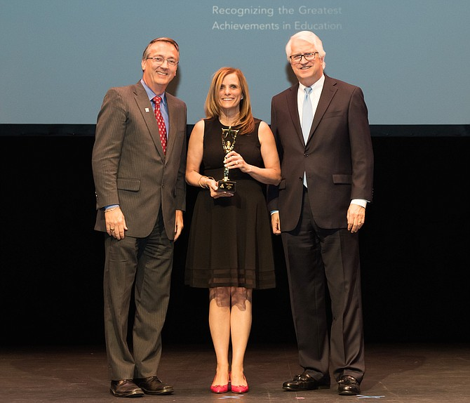 Winner of the 2019 FCPS Honors Outstanding New Principal award, Teresa Fennessy, Principal, Herndon Elementary School, pictured with Dr. Scott Brabrand, FCPS Superintendent (left) and Stewart Robenson, President Moseley Architects (right) at the FCPS Honors ceremony held June 12.