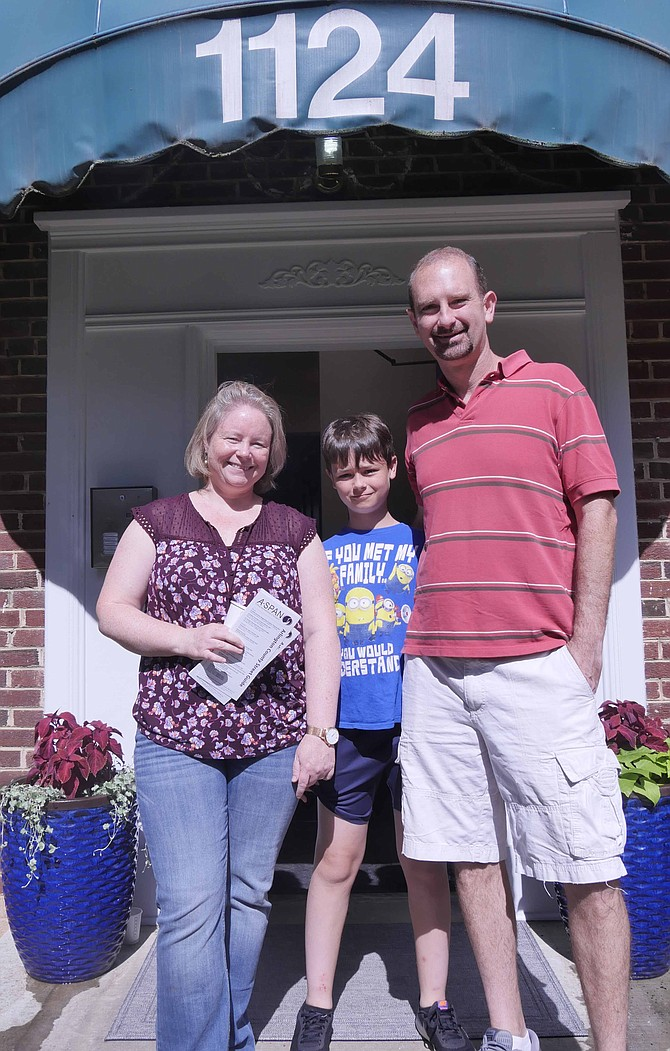 Evan and Maggie Baker and their 10-year-old son, Robbie, tour the newly opened A-SPAN apartment building in Westover on Saturday, June 22.