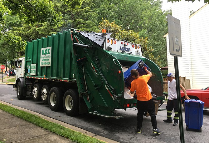 The recycle truck moves quickly through the neighborhoods.