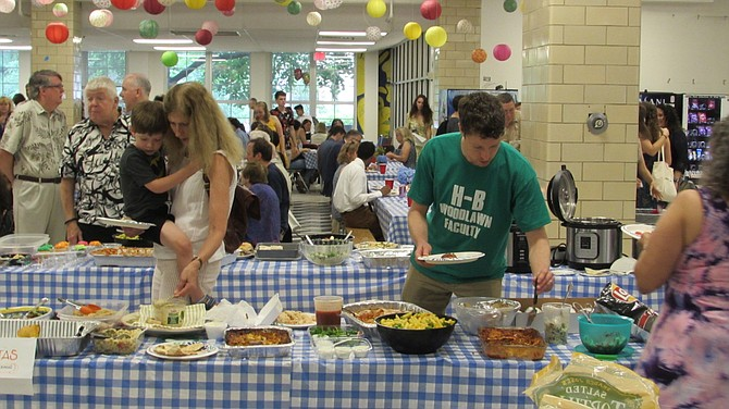 Family and faculty mingle at H-B Woodlawn's pre-graduation potluck dinner.