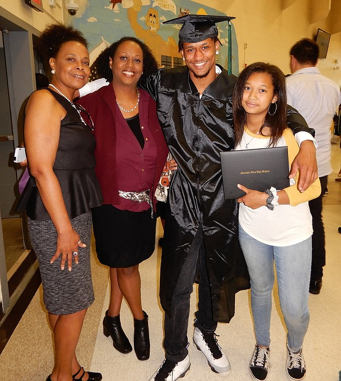 Grad Elijah Coleman with (from left) aunt Cissy Diew, mom Danielle Diew and sister Daath Coleman.