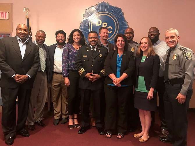 City Council members and other officials stand with the honorees at the Celebrating Our Community Leaders reception held June 24 at the Departmental Progressive Club. Shown are (from left): DPC president Merrick Malone; Alexandria Redevelopment and Housing Authority CEO and honoree Keith Pettigrew; Councilman Canek Aguirre; School board member Jacinta Greene; Acting Fire Chief and honoree Corey Smedley;  Commonwealth's Attorney Bryan Porter; Council member Amy Jackson; Assistant Police Chief and honoree Don Hayes; Vice Mayor Elizabeth Bennett-Parker; Councilman John Taylor Chapman; and Police Chief Michael Brown.