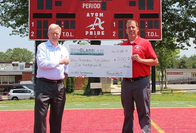 Ben Glass, of Fairfax Station, presents the $500 award to John Ellenberger, Athletics Director at Annandale High School. Head Coach and former marine Tejas Patel (not pictured) has changed the culture of the program for the better.