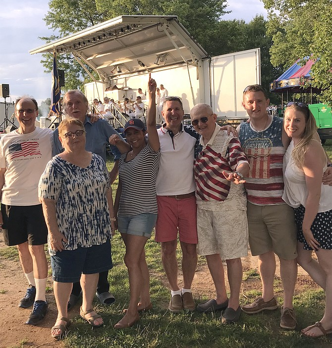 After Modern Vintage performed at the Lake Fairfax Park Independence Day Celebration, its members and their families and friends donned patriotic shirts, and spent time together ready to listen to The U.S. Navy Band Commodores perform.
